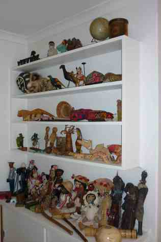 Unpacking assorted dolls, objects