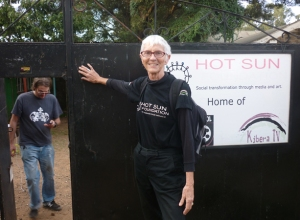 Pamela at the gate of Hot Sun Foundation in Kibera, starting her walk home