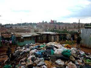 Trash heap near railroad tracks.  No regular services in Kibera.  Occasional pickup by train or truck.