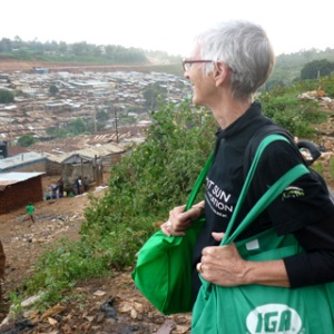 Pamela near railroad tracks looking out over Kibera