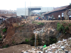 Kibera has its own waterfall: run off from construction of overpass above